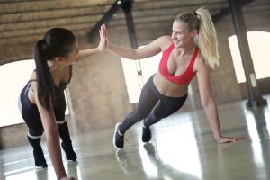 2 women high fiving & push Up |