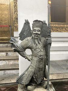 2 days Bangkok itinerary | stone Chinese guardians at Wat Pho