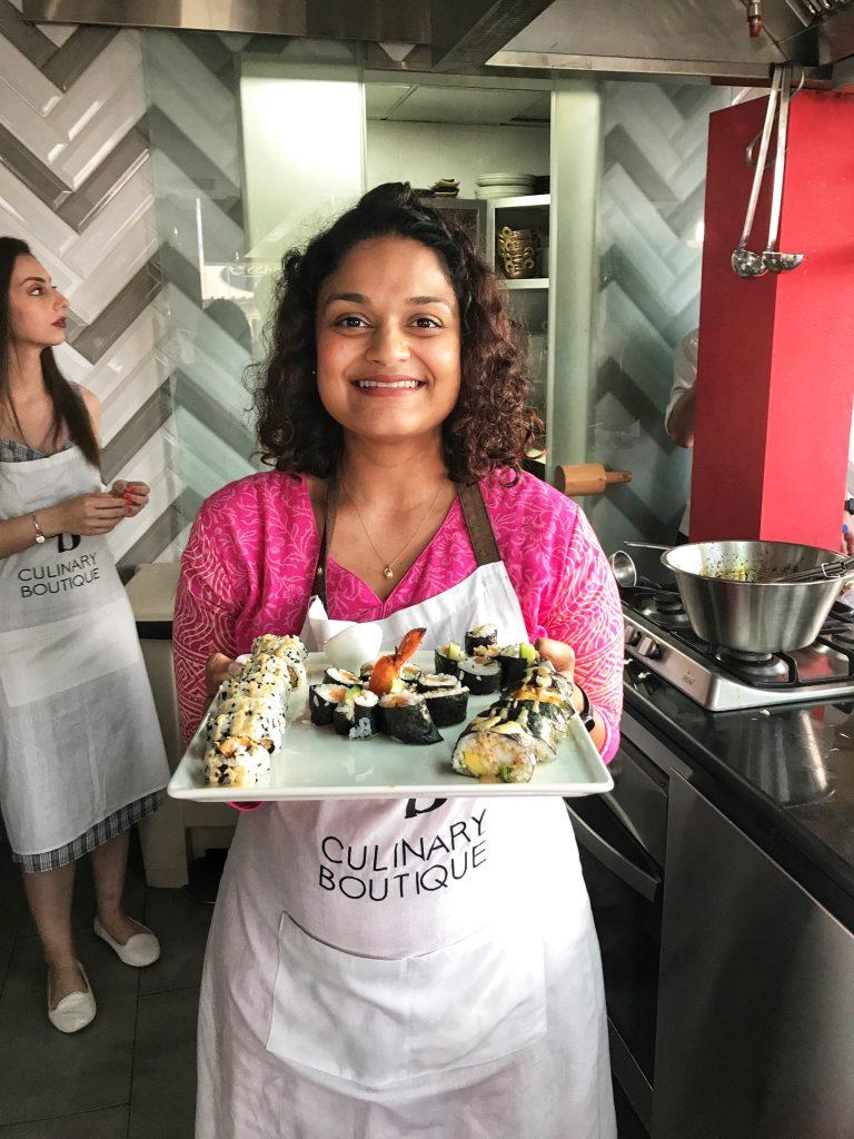 About Om Nom Nirvana | Aneesha holding sushi