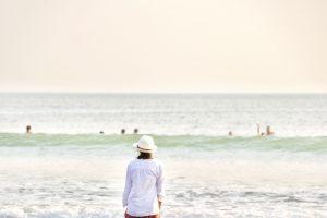 Goa 2 day trip | Woman sitting by Vagator beach